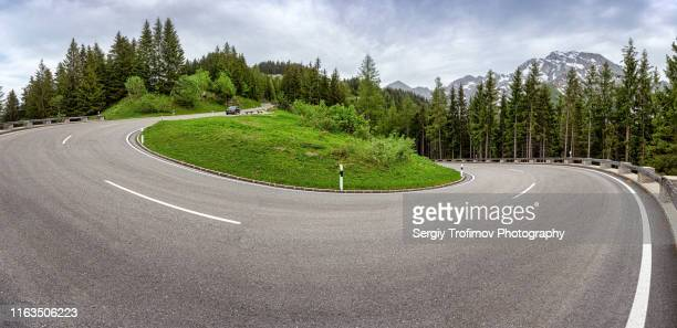 hairpin bend in mountains, panoramic photo, bavaria - mountain pass stock pictures, royalty-free photos & images