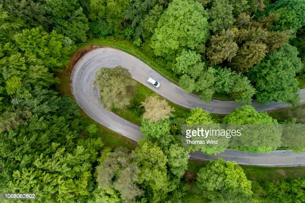 hairpin curve - thoroughfare stock pictures, royalty-free photos & images
