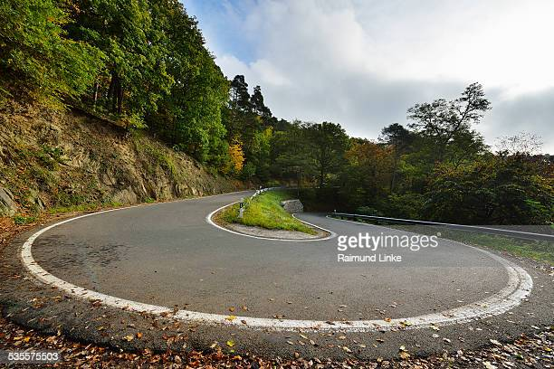 hairpin curve - hairpin curve stock photos and pictures