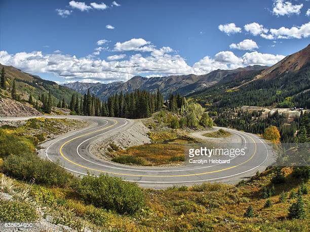 hairpin turn on highway 550 known as the million dollar highway between ouray & silverton in the rocky mountains - million dollar highway stock photos and pictures