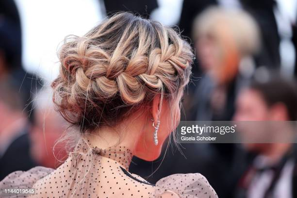 Hairs of a guest during the screening of Les Miserables during the 72nd annual Cannes Film Festival on May 15 2019 in Cannes France