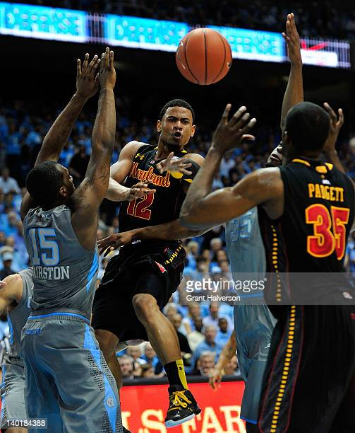 J Hairston of the North Carolina Tar Heels defends as Terrell Stoglin of the Maryland Terrapins passes to teammate James Padgett during play at the...