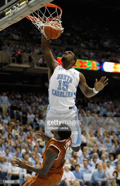 J Hairston of the North Carolina Tar Heels dunks the ball on Julien Lewis of the Texas Longhorns during their game at the Dean Smith Center on...