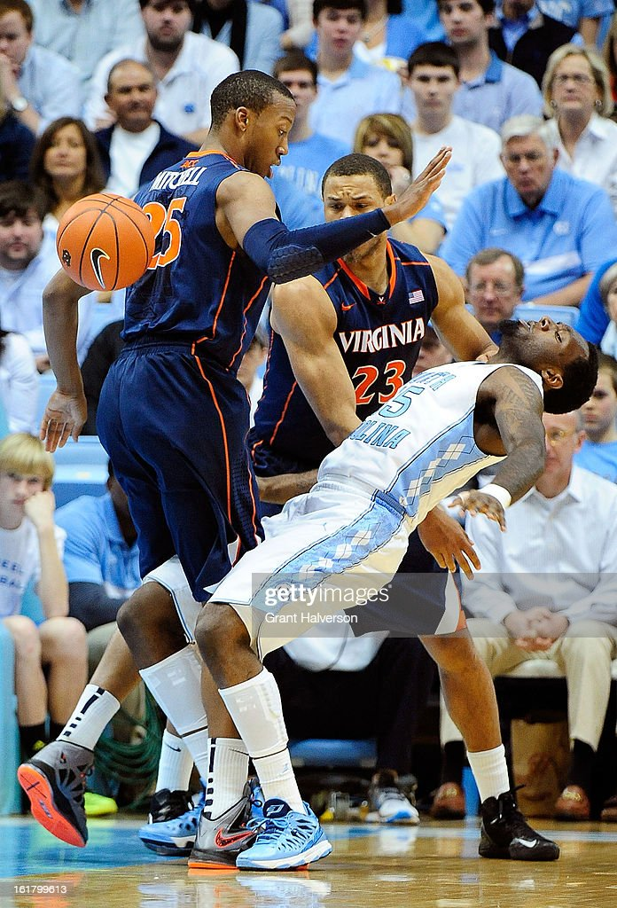 P.J. Hairston #15 of the North Carolina Tar Heels loses the ball as he collides with Akil Mitchell #25 of the Virginia Cavaliers during play at the Dean Smith Center on February 16, 2013 in Chapel Hill, North Carolina. North Carolina won 93-81.