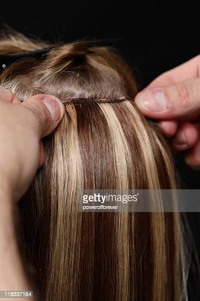 Hairstylist Applying Hair Extensions