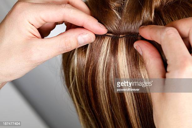 hairstylist applying hair extensions - hair clip stock pictures, royalty-free photos & images