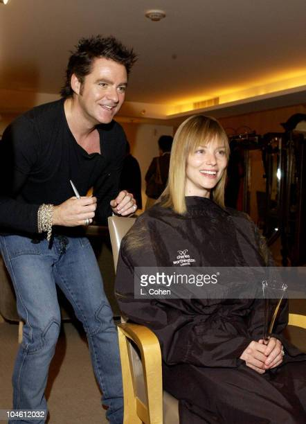 Hairstylist Charles Worthington works on styling Sienna Guillory's hair