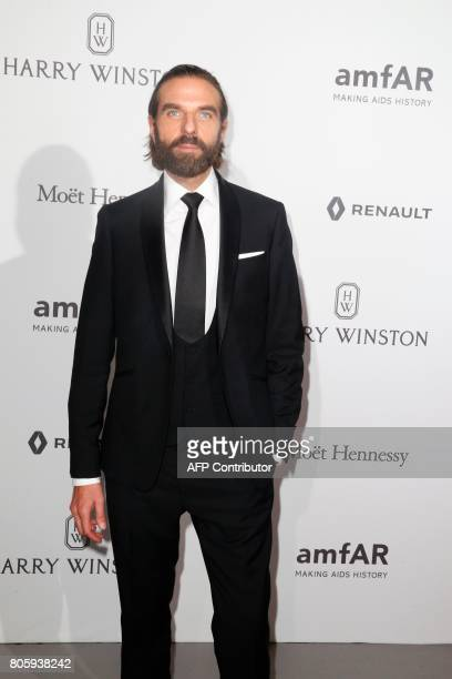 Hairstylist John Nollet poses during a photocall as part of a dinner organized by the foundation for AIDS research amfAR on July 2 2017 at the Grand...