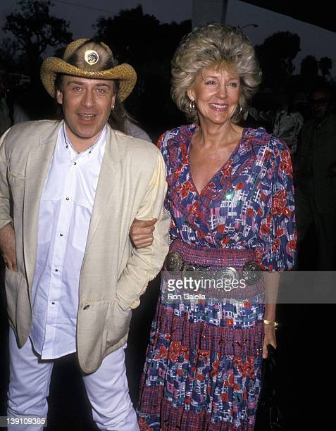 Hairstylist Jose Eber and Georgia Holt attend the 35th Annual SHARE Boomtown Party on May 21 1988 at Santa Monica Civic Auditorium in Santa Monica...