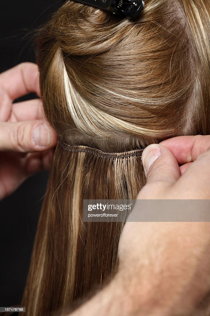 Hairstylist Putting In Hair Extensions Stock Photo Getty Images