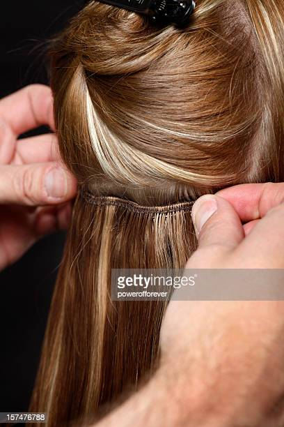 Hairstylist Putting in Hair Extensions