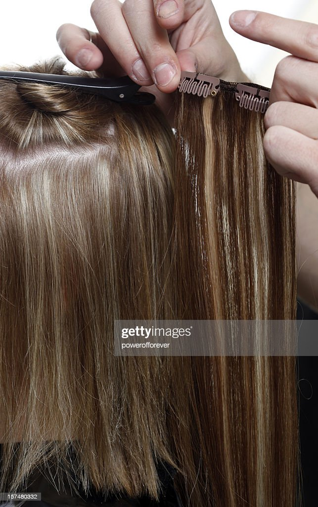 Hairstylist Putting in Hair Extensions : Stock Photo