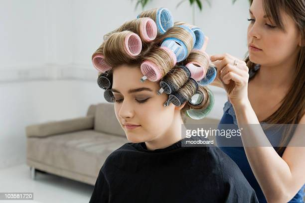 Hairstylist Rolling Hair of Model