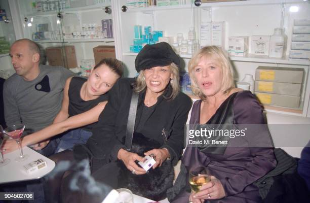 Hairstylist Sam McKnight supermodel Kate Moss actress Anita Pallenberg and singersongwriter Marianne Faithfull at the Pharmacy Club in Notting Hill...
