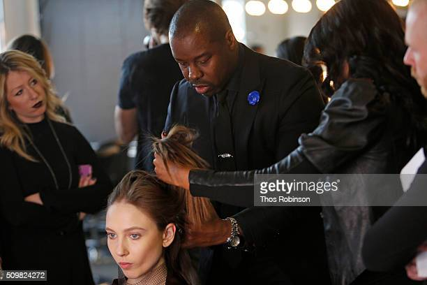 Hairstylist Ted Gibson prepares a model backstage with L'Oreal Professionnel at Pamela Rolland during New York Fashion Week at Pier 59 on February 12...