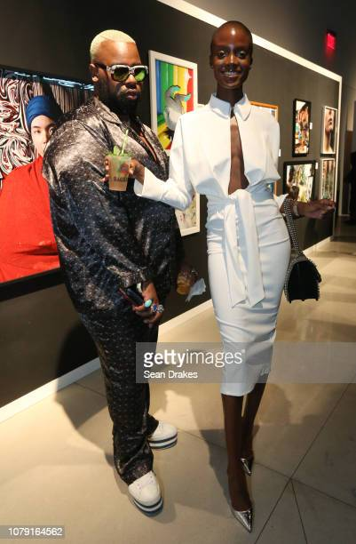 Hairstylist Tym Wallace and model Madisin Rian with Women Model Management pose at the Bacardi No Commission Marquee Performance hosted by Swizz...