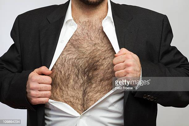 hairy chested man - hairy chest stock-fotos und bilder
