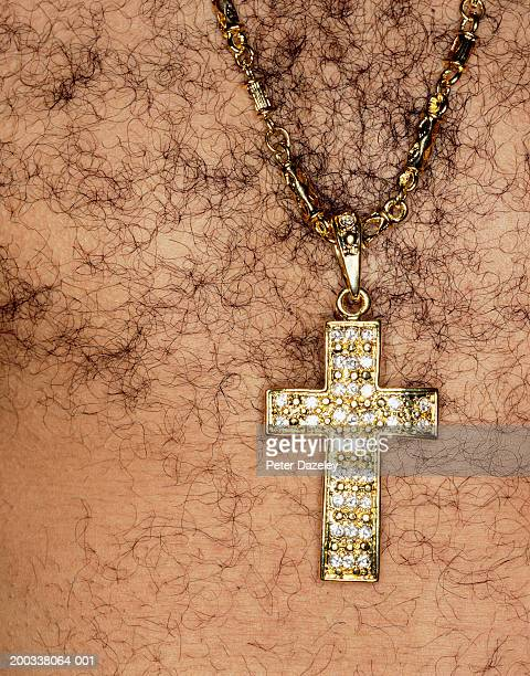 hairy chested man wearing crucifix medallion, mid section, close-up - hairy man chest stock pictures, royalty-free photos & images