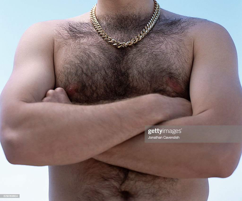 Hairy Chested Man with Gold Chain and Arms Crossed : Stock Photo