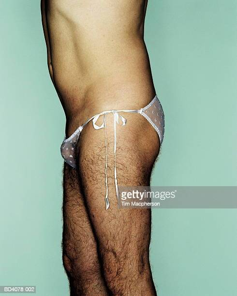 hairy man wearing woman's knickers, side view, close-up - homme en slip photos et images de collection