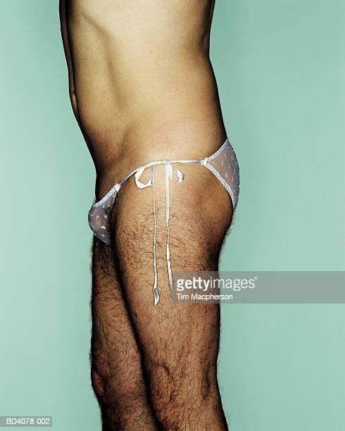 hairy man wearing woman's knickers, side view, close-up - homem de cueca imagens e fotografias de stock
