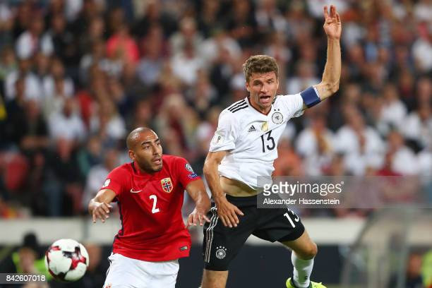 Haitam Aleesami of Norway and Thomas Muellerof Germany during the FIFA 2018 World Cup Qualifier between Germany and Norway at MercedesBenz Arena on...