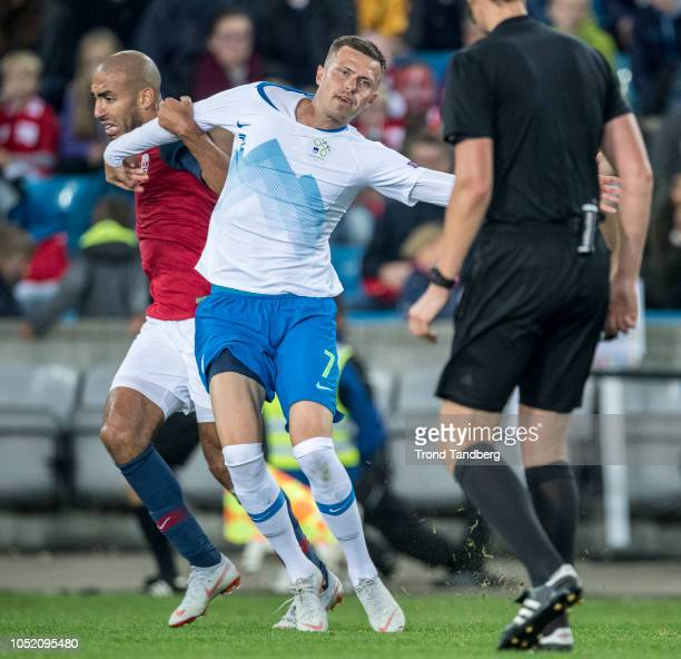Haitam Aleesami of Norway, Josip Ilicic of Slovenia, Referee Daniel Siebert of Germany during the UEFA Nations League C group three match between...