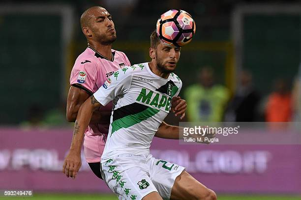 Haitam Aleesami of Palermo and Domenico Berardi of Sassuolo compete for the ball during the Serie A match between US Citta di Palermo and US Sassuolo...