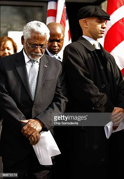 Haitan Ambassador to the United States Raymond Joseph and District of Columbia Mayor Adrian Fenty bow their heads in prayer during a news conference...