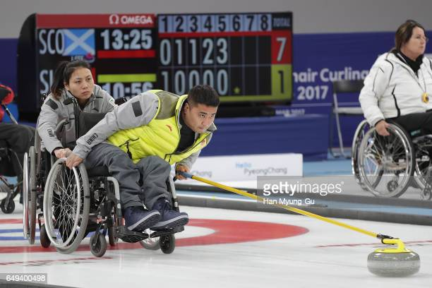 Haitao Wang from China delivers a stone reacts during the World Wheelchair Curling Championship 2017 test event for PyeongChang 2018 Winter Olympic...