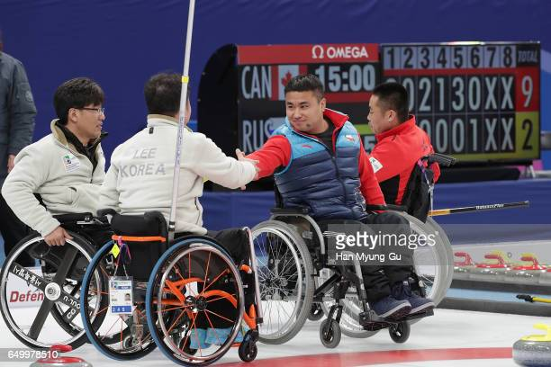 Haitao Wang from China shakes hands with Lee DongHa from South Korea after winning round robin session 12 in the World Wheelchair Curling...