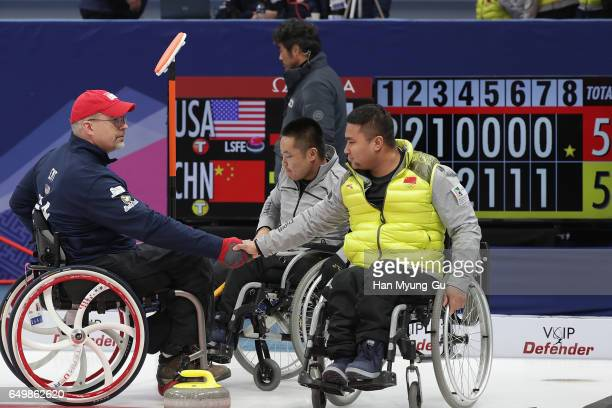 Haitao Wang from China shakes hands with Stephen EMT from USA after winning round robin session 11 the World Wheelchair Curling Championship 2017...