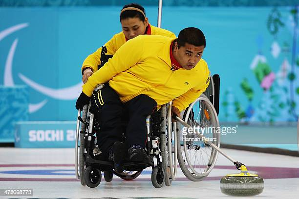 Haitao Wang of China competes in the wheelchair curling round robin session 9 match between Korea and Canada on day five of Sochi 2014 Paralympic...