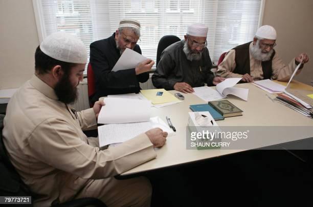 Haitham alHaddad Dr Suhaib Hasan Maulana Abu Sayeed and Mr Mufti Barabatullah of the Sharia Council of Britain preside over marital cases at their...