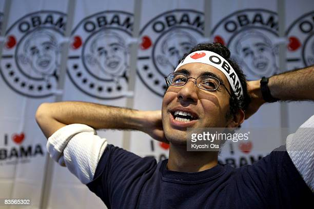 Haitham Jendoubi US resident in Japan wears a headband to show his support for the Democratic presidential candidate US Sen Barack Obama before the...