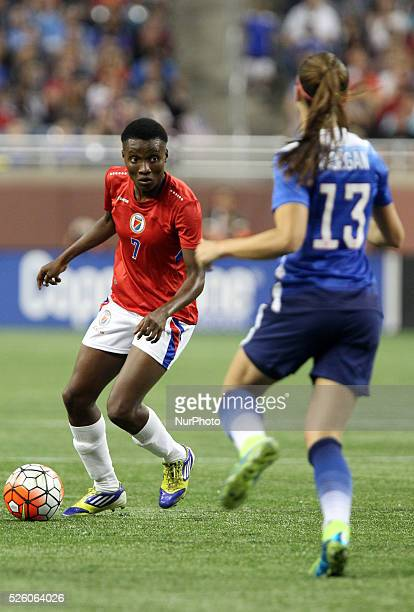 Haiti defender Roselord Borgella looks to pass under the pressure of US forward Alex Morgan during the International Friendly match between the...