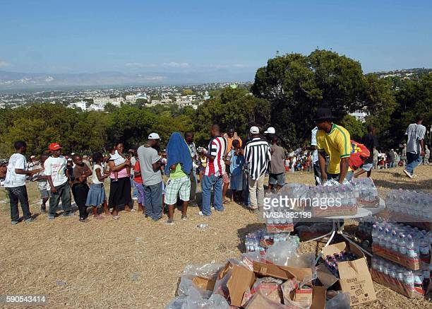PRINCE Haiti Haitian citizens that were affected by the 70 magnitude earthquake on Jan 12 2010 stand in line to receive bottled Photo by MC2 Laura A...