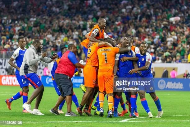 Haiti players celebrate their victory over Canada during the Quarterfinals match between Haiti and Canada as part of the 2019 CONCACAF Gold Cup on...