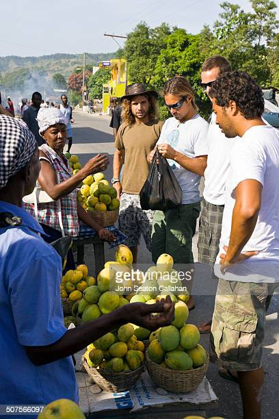 Haiti, Sud-Est, buying fruit from roadside vendors near Jacmel.