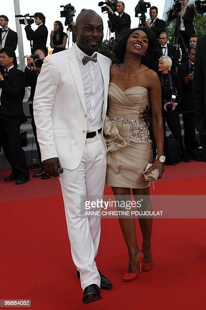 Haitian actor Jimmy JeanLouis and Evelyn Stock arrive for the screening of Des Hommes et des Dieux presented in competition at the 63rd Cannes Film...