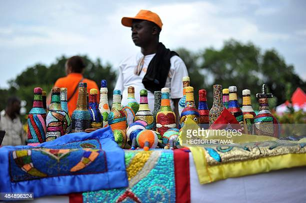 A Haitian artist exhibits his creations at the Grand Market during Carifesta 2015 in Champ de Mars in the center of PortauPrince on August 22 2015...