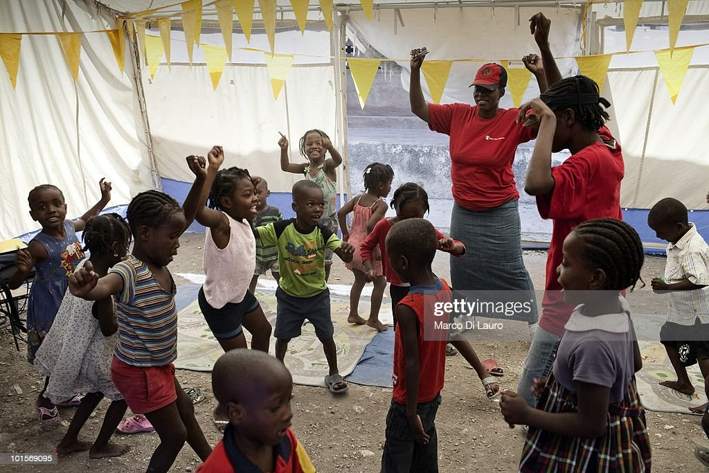 Haitian child play in a 'Child Friendly Space' managed by The Save the Children NGO in a temporary camp on February 2, 2010 in Port Au Prince, Haiti. As many as 200,000 people died on January 12 as a consequence of the 7.0-magnitude earthquake. At least 130 people have been pulled alive from the rubble. An estimated 1.5 million people have been left homeless. The Haitian government is planning to relocate some 400,000 people, currently in makeshift camps across the capital, to temporary tent villages outside the city. Aid agencies are still struggling to supply food and water to survivors, while thousands of Haitians who suffered serious injuries remain in need of urgent medical attention.