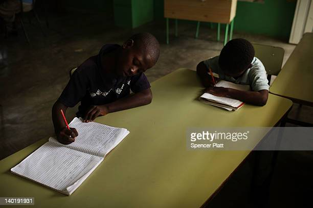 Haitian children attend school on a batey on February 29 2012 in San Pedro Dominican Republic A batey is the name given to communities that reside...