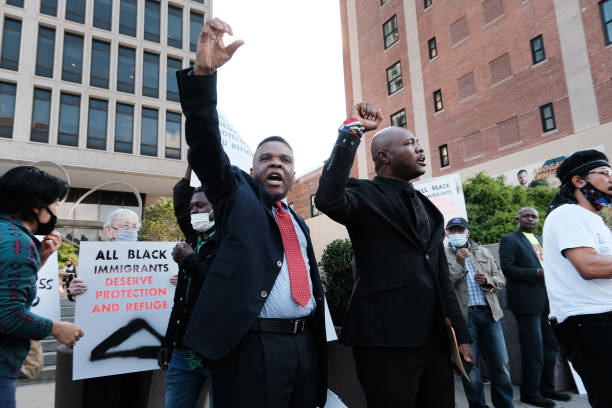 NJ: Haitian Community Protests Outside ICE Office Demanding End To Deportations