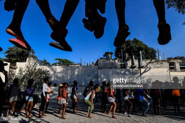 Haitian dancers dance during rehearsals for the upcoming 2020 National Carnival Parade in Port-au-Prince, on February 13, 2020. - Under the watchful...