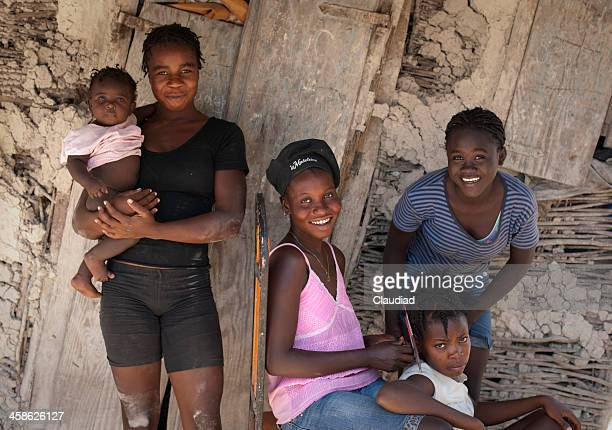 Haitian family in front of their house