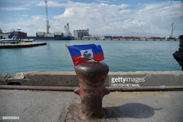 A Haitian flag is seen in a wharf of the port in the haitian capital PortauPrince on August 11 2017 / AFP PHOTO / HECTOR RETAMAL