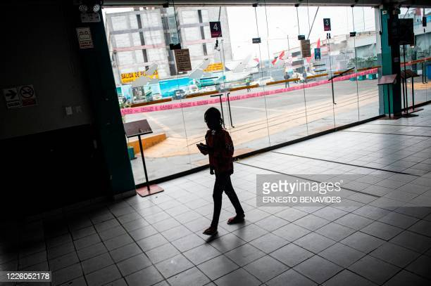 A Haitian girl walks at a bus station hall in Lima on July 10 2020 On March 16 2020 the order of compulsory national confinement due to the COVID19...