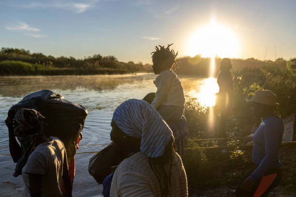 Haitian immigrant families cross the Rio Grande into Del Rio, Texas on September 23 from Ciudad Acuna, Mexico. Mexican immigration officials had...