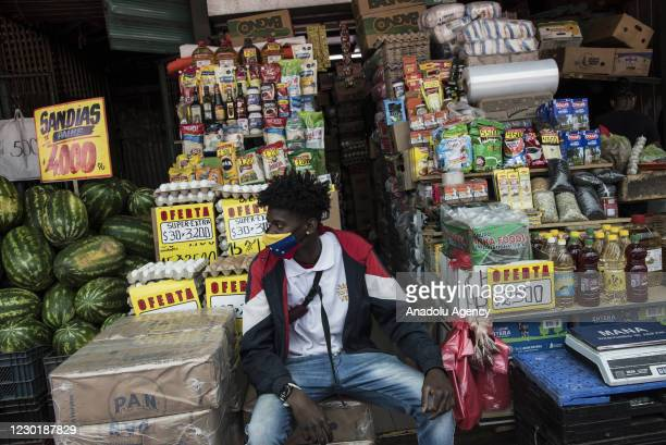 Haitian immigrants selling products on the streets in the outskirts of the Santiago, Chile on December 17, 2020.I hope some of the photos can serve...